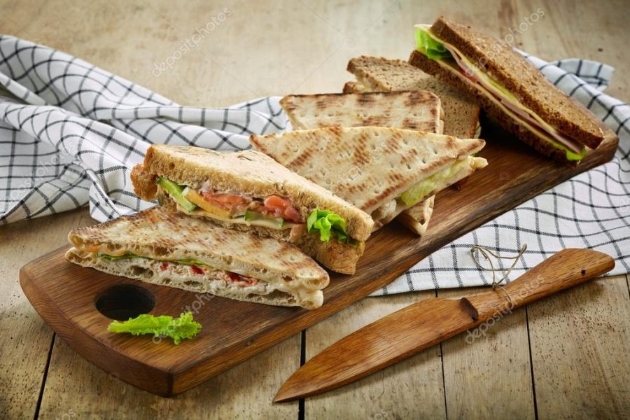depositphotos_127518122-stock-photo-various-triangle-sandwiches-on-wooden
